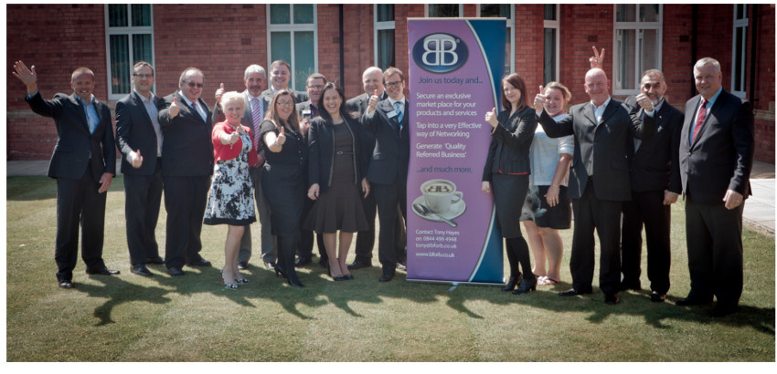 A collection of investors celebrate their franchising success